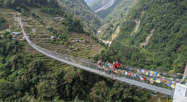 Crossing the longest suspension bridge at Jinu Danda on the way to Annapurna base camp trek