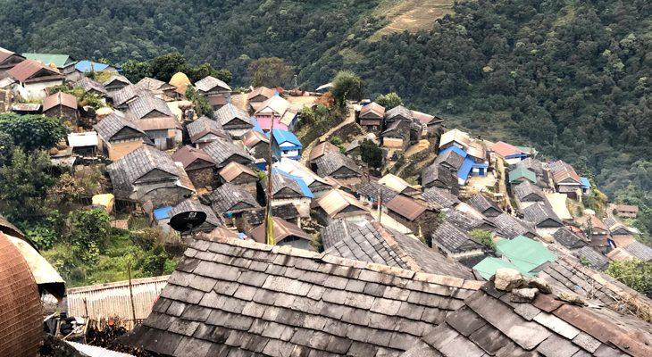 En route to Gurung Heritage Trail Trek walking through traditional Bhujung village