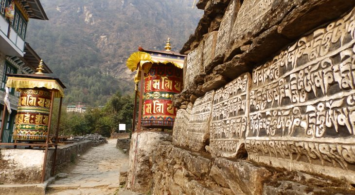 Buddhist stupa and colored chhorten en route of everest view trek