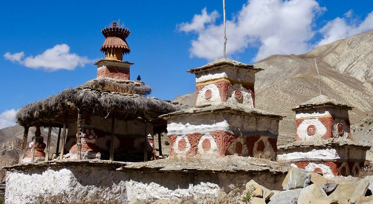 Elaborate red and white painted Buddhist stupa at Shey Gompa in Upper Dolpo Trek