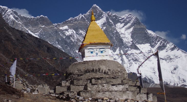 Colorful Buddhist stupa and mount Everest in Khumbu region