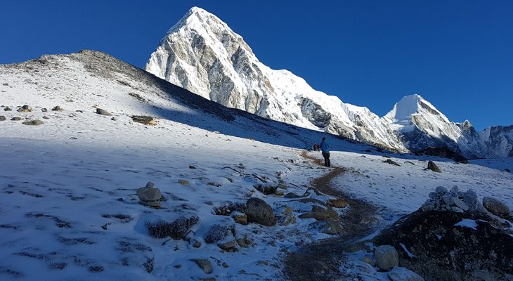 Steady climbing up to Kala Patthar summit for the best view of Mount Everest