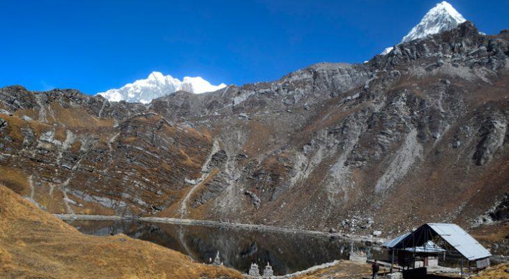 Sacred Khayer Lake with Mount Annapurna south and crest of Nilgiri peak on Khayer Lake and Khopra Ridge Trek