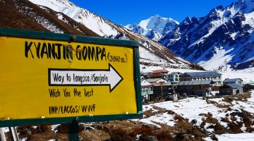 Dramatic view of Kyanjin Gompa and Mount Gangchenpo in the Langtang valley trek
