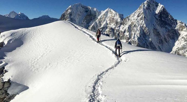 Climber pushing themselves towards the summit of Lobuche peak