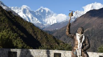 Statue of legendary climber Tenzing Norgay with mount Everest on backdrop at Namche Bazar