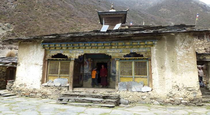 Mu gompa, a beautiful Buddhist monastery in Tsum valley and surrounding by snow peak and wild yak beyond the human settlement.
