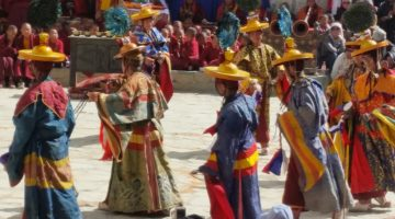 Monks are dancing during the 3 days Tiji festival
