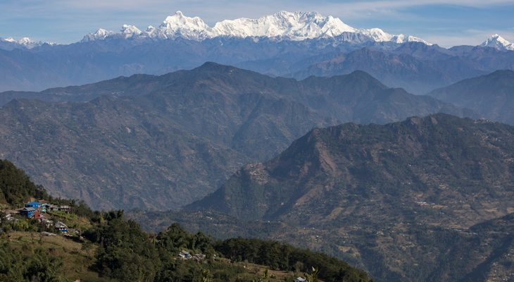Breathtaking view of Kanchenjunga mountain range and dotted sloppy mountain in Kanchenjunga Circuit Trek
