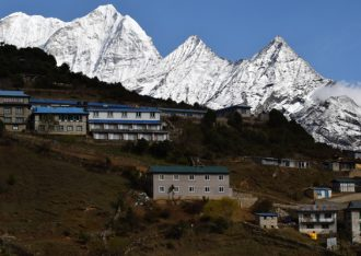 Everest Region Trek provides excellent mountain vista above cultural Sherpa village.