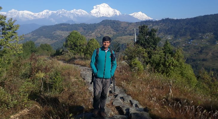 En route of Mohare Danda Trek, exposing magnificent mount Dhaulagiri on backdrop with rice terraced