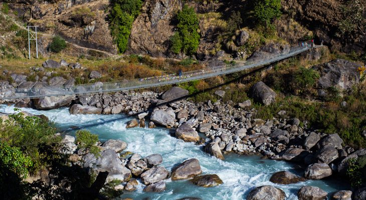 Turquoise Marshyandi River and suspension bridge en Route Manang Jeep Tour