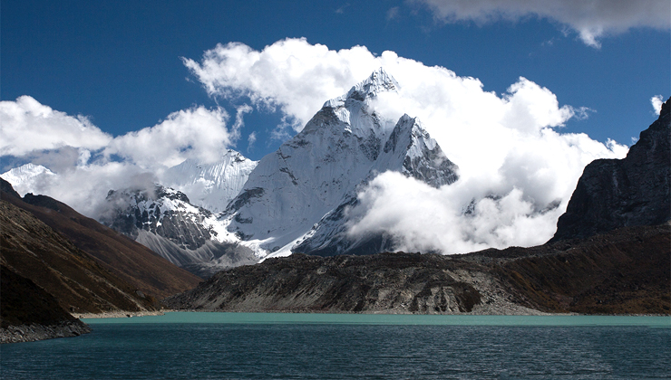 A side trip to Chola Lake offers breathtaking mountain vista and turquoise glacier lake in the Everest region trek.