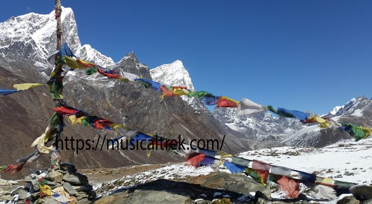 The Buddhist flag is puffing into the thin air on way Lukla to Everest base camp trek.