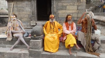 The holy man are giving pose for the photograph in the Pashupatinath temple during the one day Kathmandu valley tour