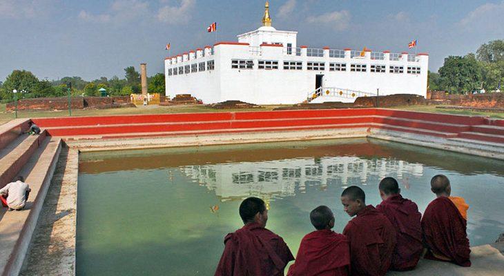 Maya Devi temple and sacred pond with monks at Lumbini garden on Lumbini Tour