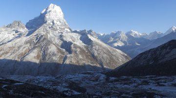 Himalayas seen above the alpine valley on the Khari Khola to Everest base camp trek